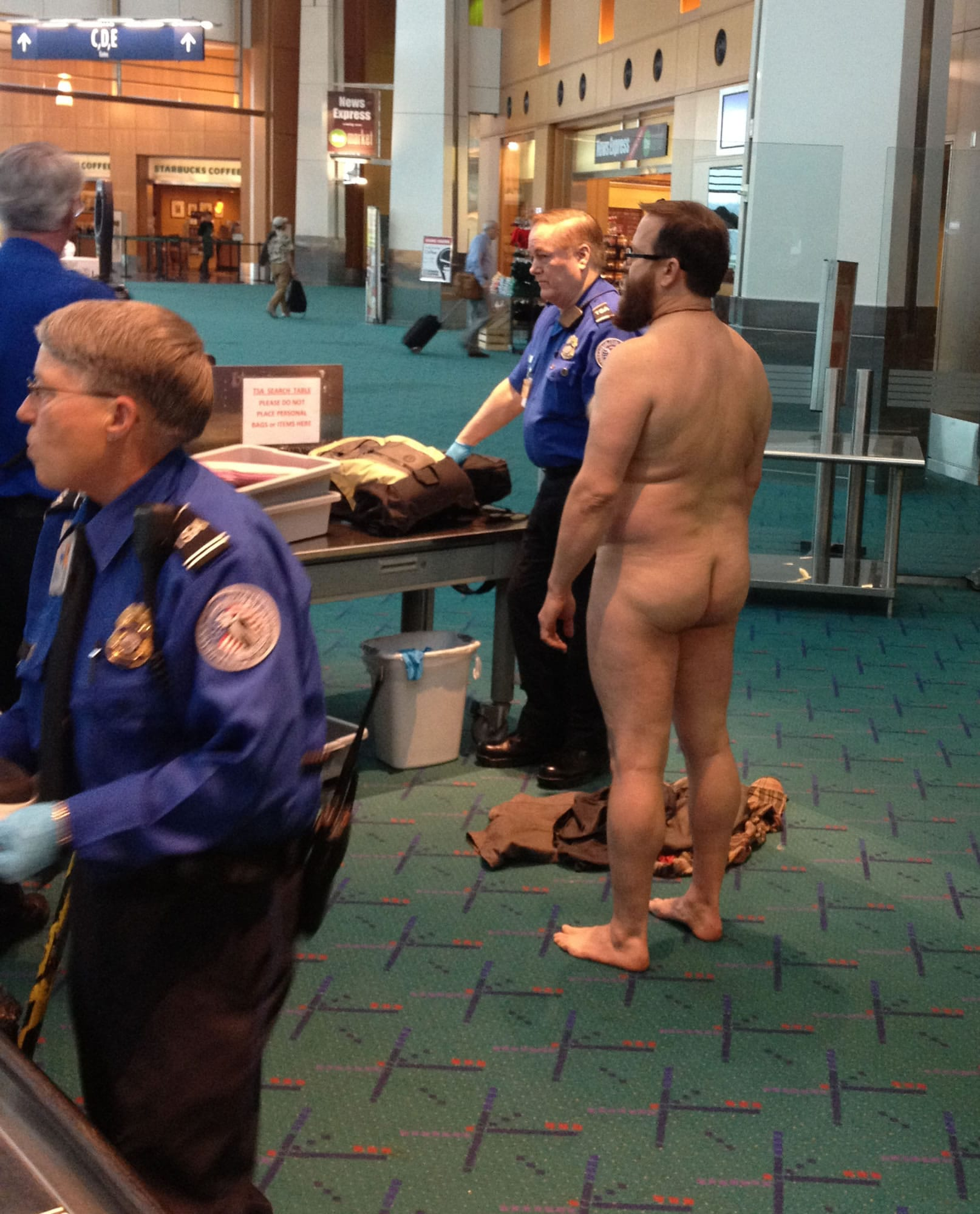 This photo taken at Portland International Airport in April shows John E. Brennan standing naked after he stripped down while going through a security screening area to protest against security procedures.