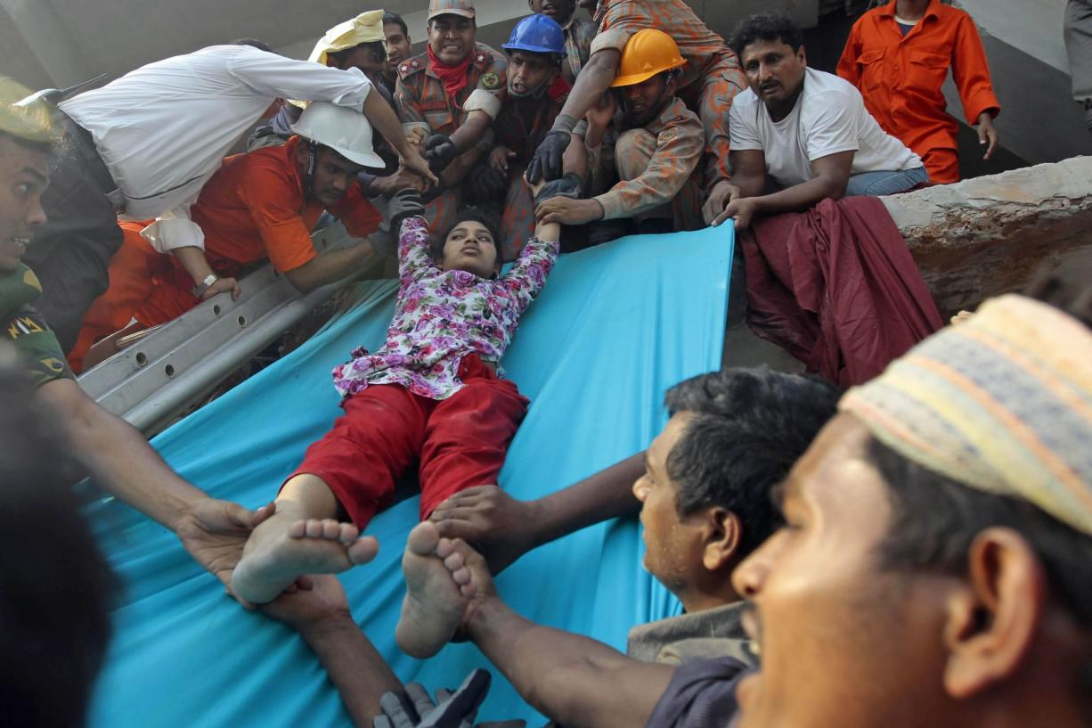 Collapsed factory building in Bangladesh kills 87