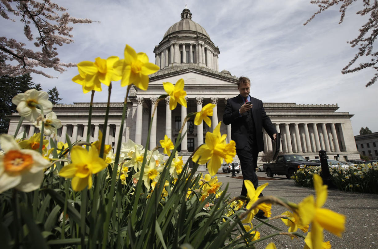 The Legislative Building at the Capitol in Olympia, Wash., is shown through as daffodils bloom, Tuesday, April 10, 2012.