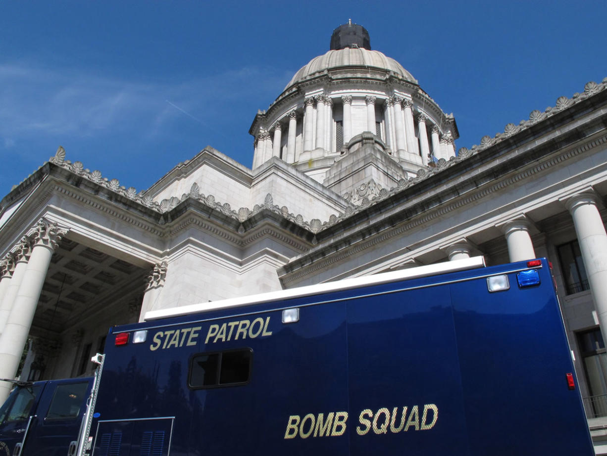 Associated Press files A bomb squad truck is parked outside the Washington state Capitol in Olympia on Aug. 13 during an evacuation prompted by a suspicious package left in the rotunda.