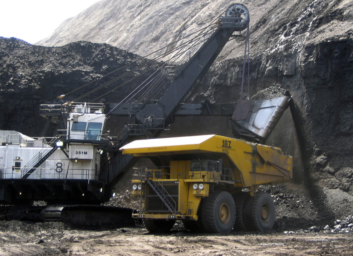 A shovel prepares to dump a load of coal into a 320-ton truck at the Black Thunder Mine in Wright, Wyo., in 2007.