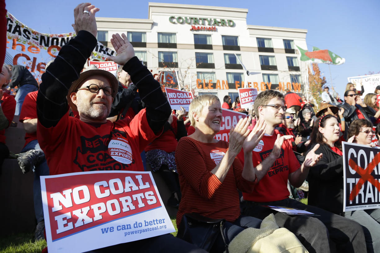Russ Childers, left, of Seattle, sits among other protesters as they demonstrate against trains carrying coal for export moving through Washington state on Thursdayin Tacoma. The protest occurred prior to the fifth and final public hearing on the environmental impact statement for a proposed coal export terminal in Longview.