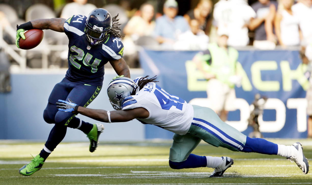 Seattle Seahawks' Marshawn Lynch (24) rushes past Dallas Cowboys' Danny McCray during the second half Sunday.