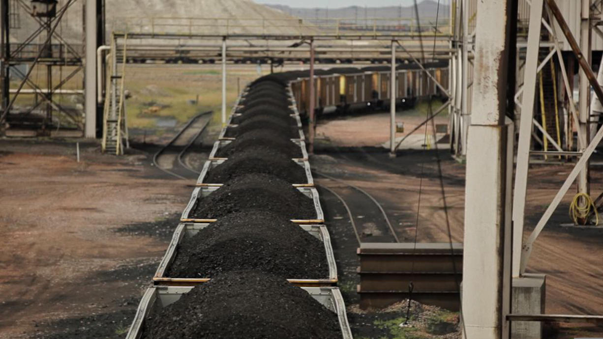 Coal trains being loaded at the Black Thunder Mine in the Powder River Basin in Northeast Wyoming.