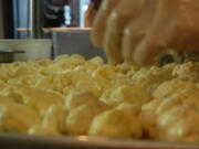 A prep cook works over cauliflower before the dinner rush at Portland restaurant.