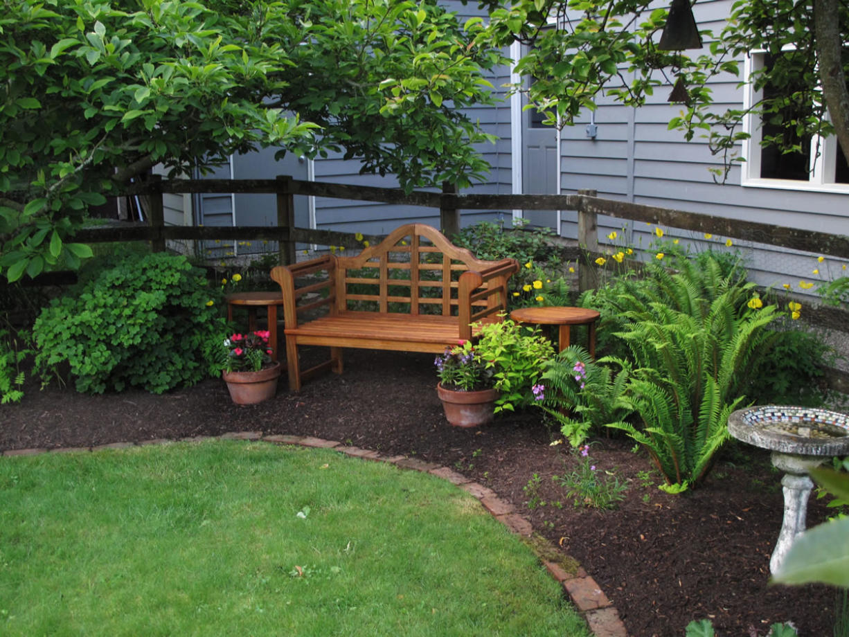 The lawn remains the centerpiece in this yard but was greatly downsized and shaped by a landscaped perimeter with furniture, statuary and a variety of perennials. Less mowing, less watering and fewer chemicals was the result.