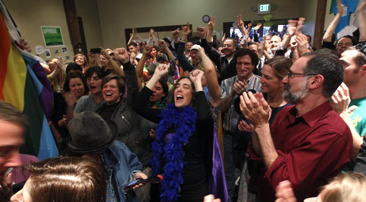 Supporters of Referendum 74, which would uphold the state's new same-sex marriage law, cheer at a news conference Wednesday in Seattle. Supporters of gay marriage in Washington declared victory Wednesday, saying they don't see a way for their opponents to prevail as votes continue to trickle in on Referendum 74.