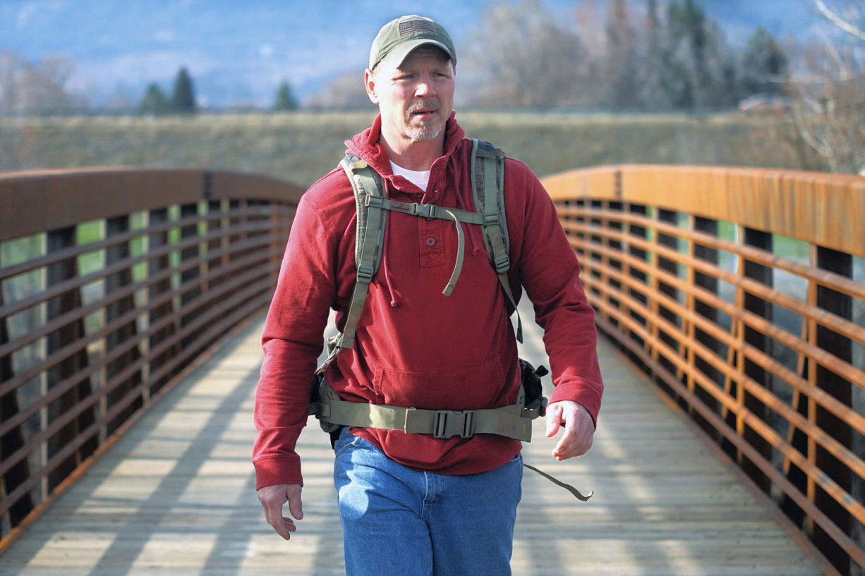 Chris Baxter/The Observer (La Grande, Ore.) Joe Bell crosses a bridge at Riverside Park in La Grande, Ore., on March 19 in his preparations to walk across the United States to honor his late son, Jadin, and promote an anti-bullying program. Bell, the father of a gay Oregon teenager from who hanged himself is ready to begin walking across the United States to spread his message against bullying.