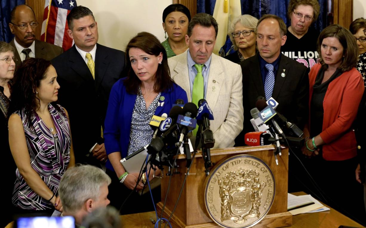 Nicole Hockley and other parents of victims of the Sandy Hook elementary school shooting talk to media at the New Jersey Statehouse in Trenton on April 30, where they joined gun control advocates to ask the state and Gov.