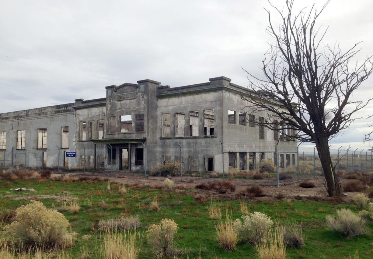 The ruins of the old Hanford High School are shown near Richland. The towns of Hanford and White Bluffs were evacuated to make room for the Hanford Nuclear Reservation, which made the plutonium for the atomic bomb dropped on Nagasaki, Japan, and the ruins of the high school and other buildings are now part of the nation's newest national park, called the Manhattan Project National Historic Park. (Courtesy of the U.S.