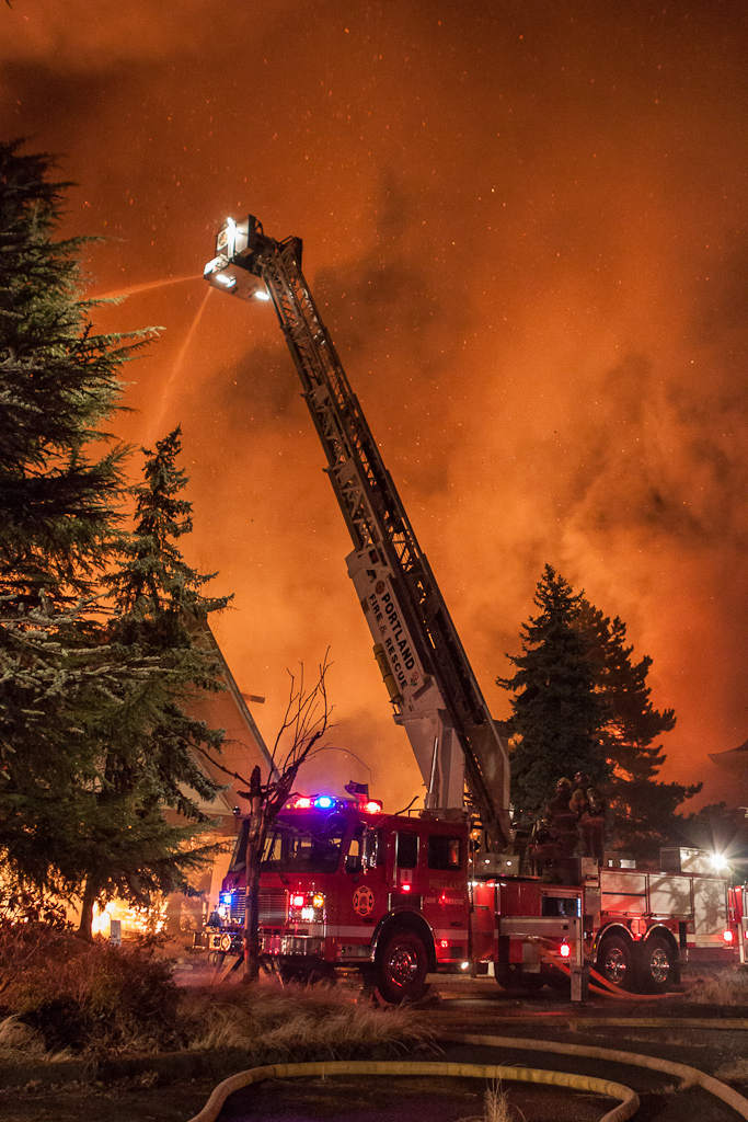Firefighters battle a five-alarm fire at the former Red Lion Hotel on Jantzen Beach early Sunday morning.