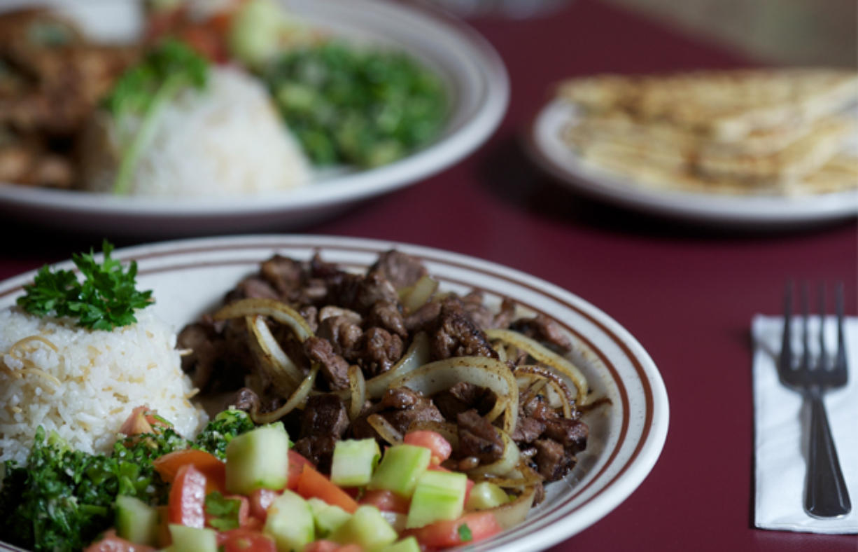 The Garlic Lemon Chicken and Lamb Shawarma, foreground, are two standout menu items available at the downtown Vancouver Jerusalem Cafe.