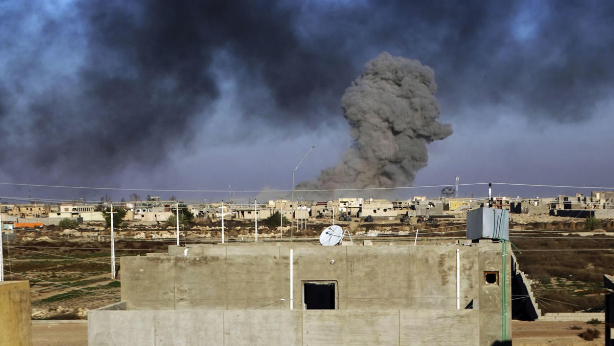 Smoke rises from Islamic State positions Friday following a U.S.-led coalition airstrike as Iraqi forces advance during their drive to retake the Islamic State-held town of Ramadi, 70 miles west of Baghdad, Iraq.