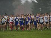 Runners take off at the starting gun for the men's race at the NAIA Cross Country National Championships on Saturday, Nov.