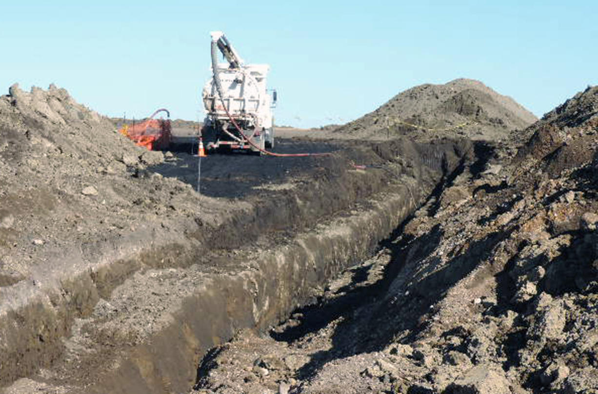 A vacuum trucks cleans up oil in near Tioga, N.D. on Oct. 8. The North Dakota Health Department says more than 20,000 barrels of crude oil have spewed out of a Tesoro Corp. oil pipeline in a wheat field in northwestern North Dakota. Officials say the 20,600-barrel spill, among the largest recorded in the state, was discovered on Sept.