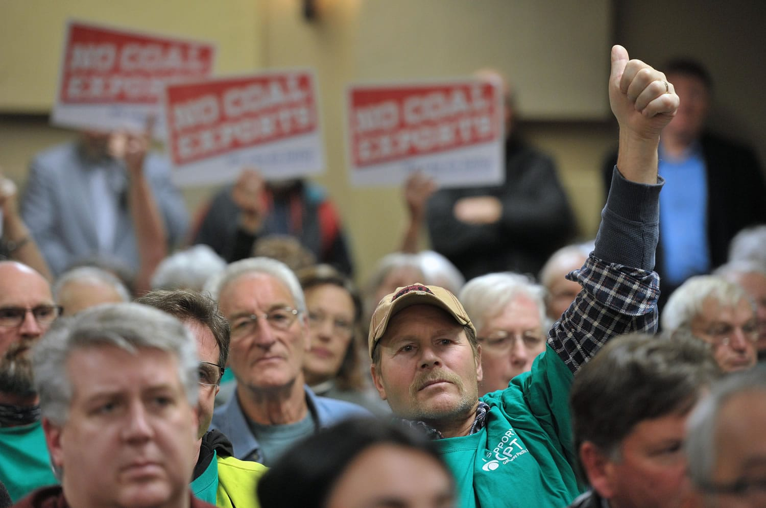 Jasper deHoog of Burlington gives a thumbs-up to a speaker supporting construction of a Gateway Pacific Terminal, which would export coal to Asia, at a meeting Nov.