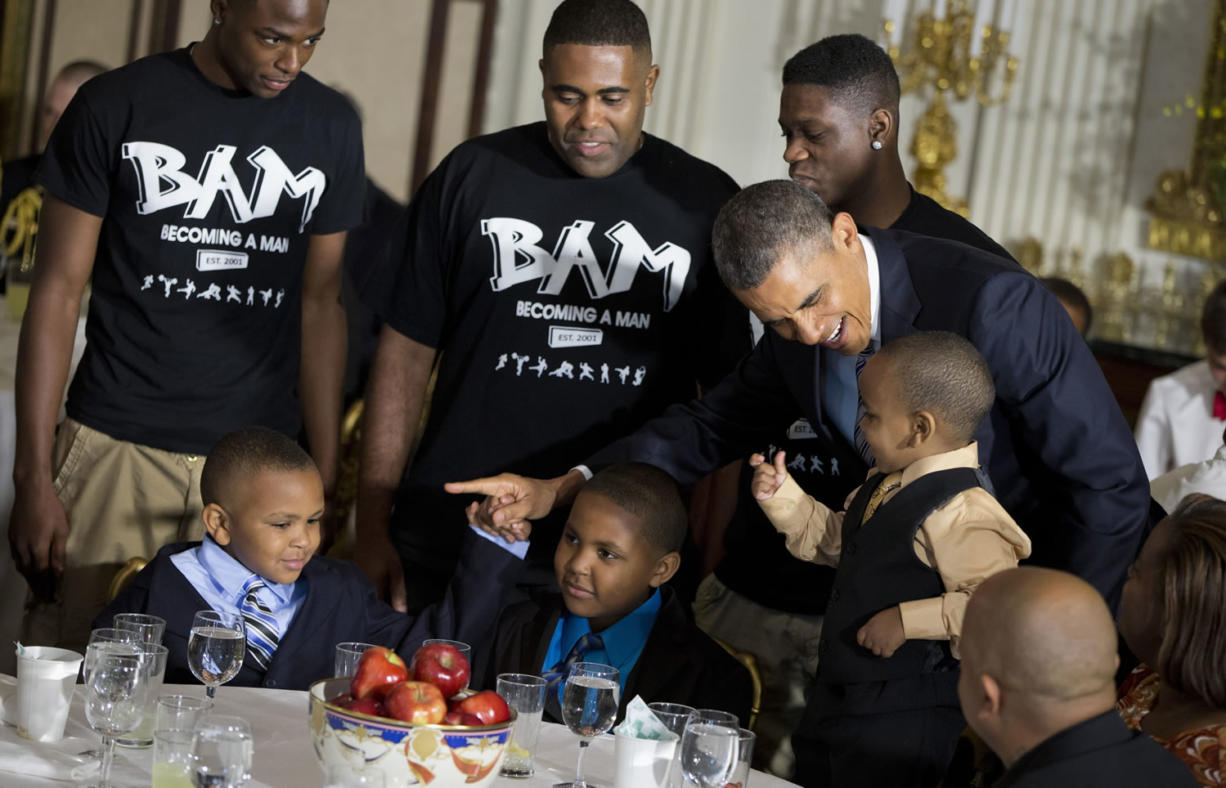 President Barack Obama greets guests, including fathers and their children participants in the Becoming a Man (BAM) program at Hyde Park Academy in Chicago, on Friday  in the State Dining Room of the White House in Washington, where the president hosted a Father's Day luncheon.