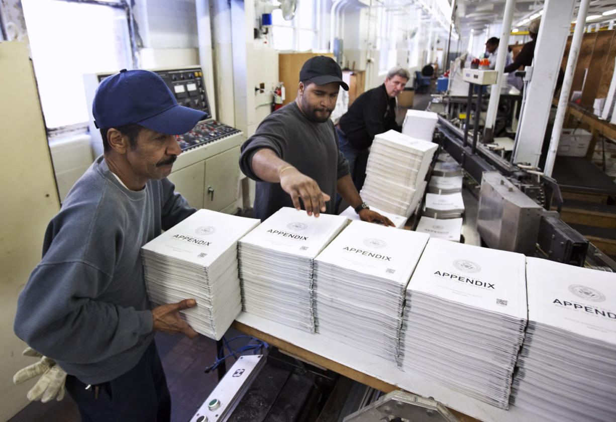 Government Printing Office employees ready copies of President Barack Obama's fiscal 2013 federal budget books in February in Washington.