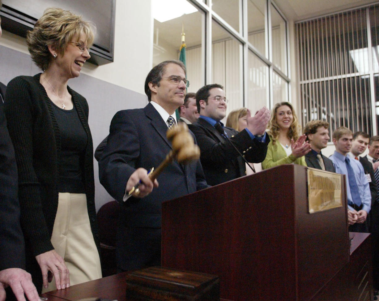 In this 2004 file photo, Lt. Gov. Brad Owen with his wife, Linda, strikes the gavel in the Senate ending the session in Olympia.