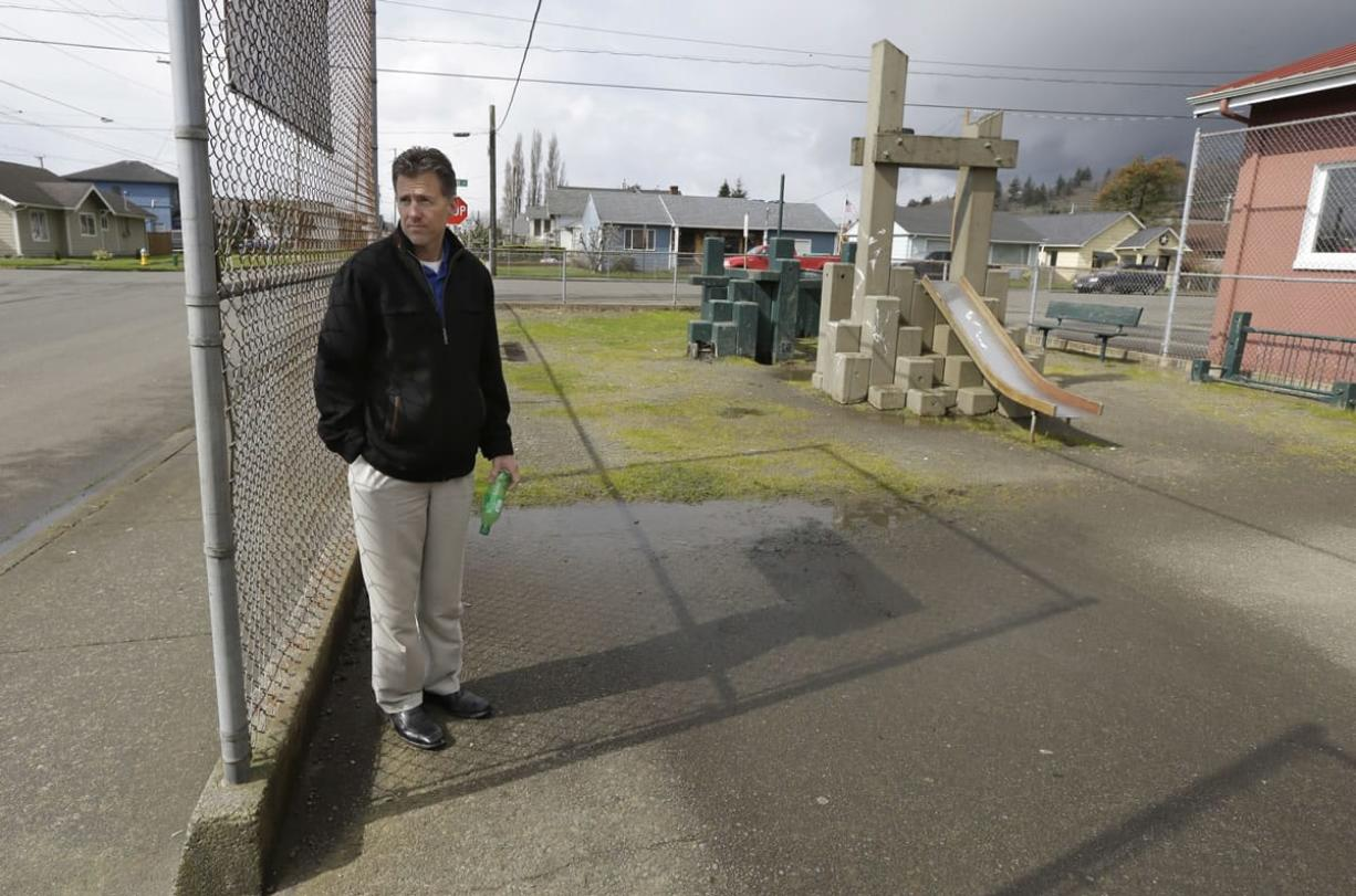 Brian Shay, city administrator of Hoquiam, stands next to a run-down playground that is next to an old fire station that the city plans to replace.