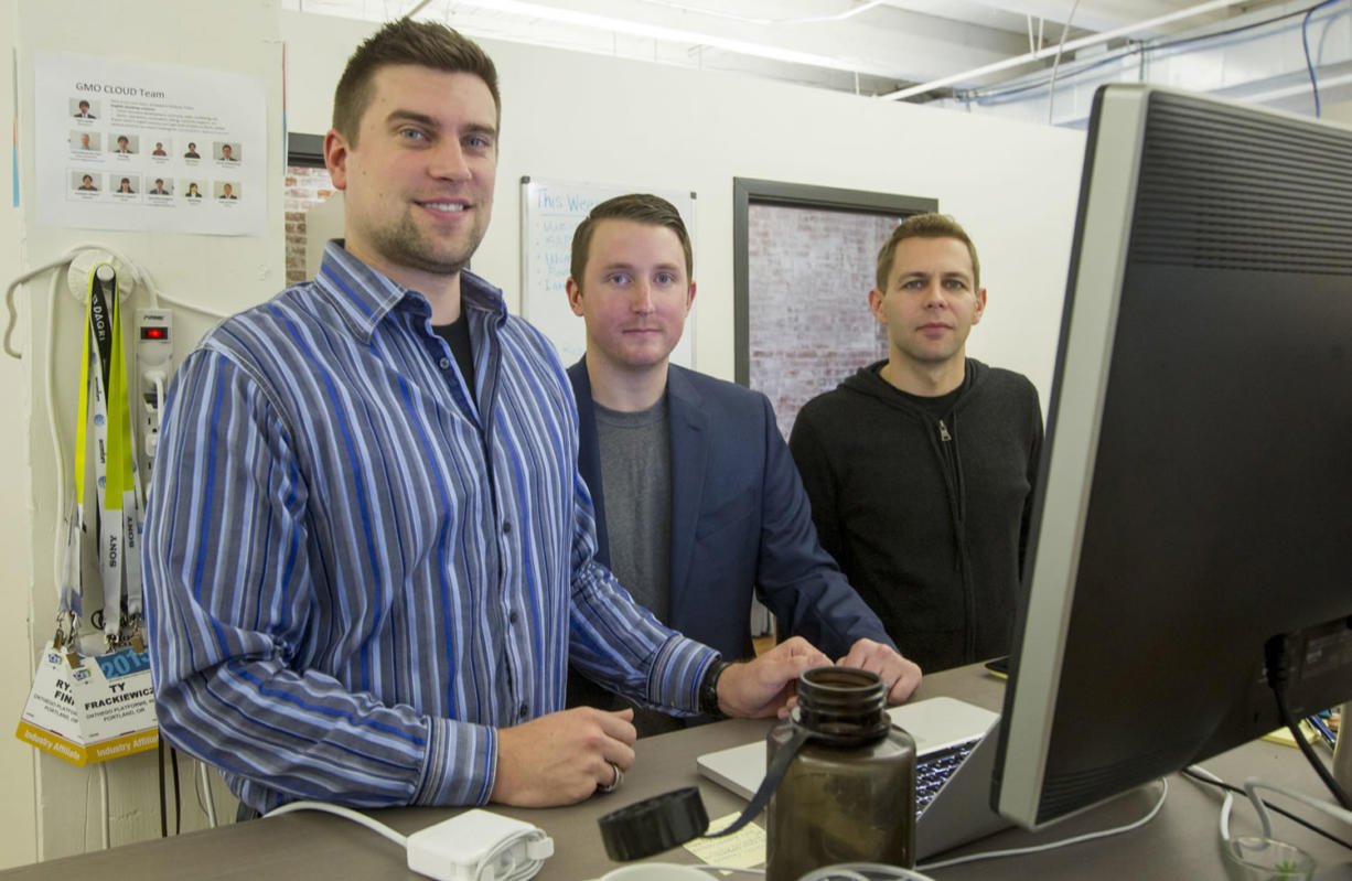 Ty Frackiewicz, from left, and Ryan Fink and Gary Peck, co-founders of ONtheGO Platforms, will remain in Portland following the recent sale of their gesture software company to Atheer, a Mountain View, Calif., developer of software for smart glasses.