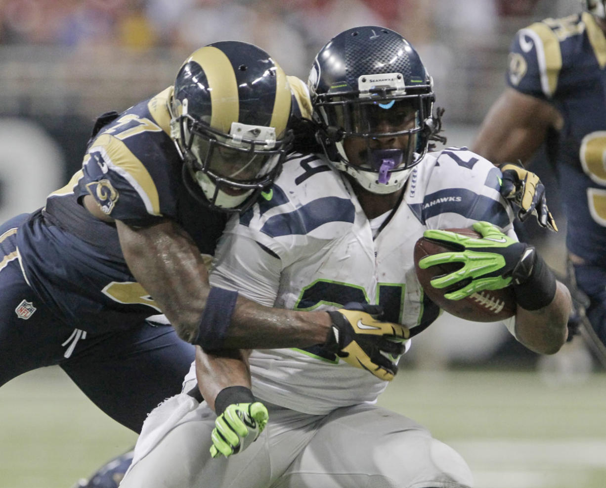 Seattle Seahawks running back Marshawn Lynch is tackled by St. Louis Rams free safety Quintin Mikell during the second half Sunday.