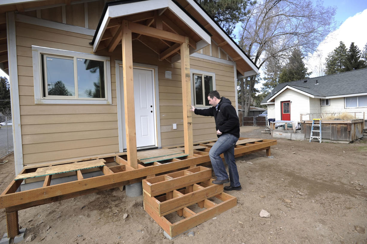 Ryan Davies walks into his accessory dwelling unit behind his home in Bend, Ore., on Thursday.