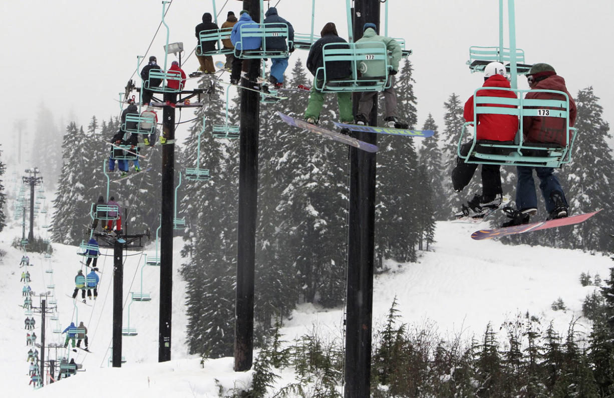 Skiers and snowboarders ride a chairlift at Stevens Pass, Wash.  on Nov. 20 2013, when Stevens became the first ski area in the state to open.  The mountain snowpack in Washington is 112 percent of normal and the best in the West, where the average for other states is about 75 percent, a water supply specialist with the Natural Resources Conservation Service said Friday, April 5, 2013.
