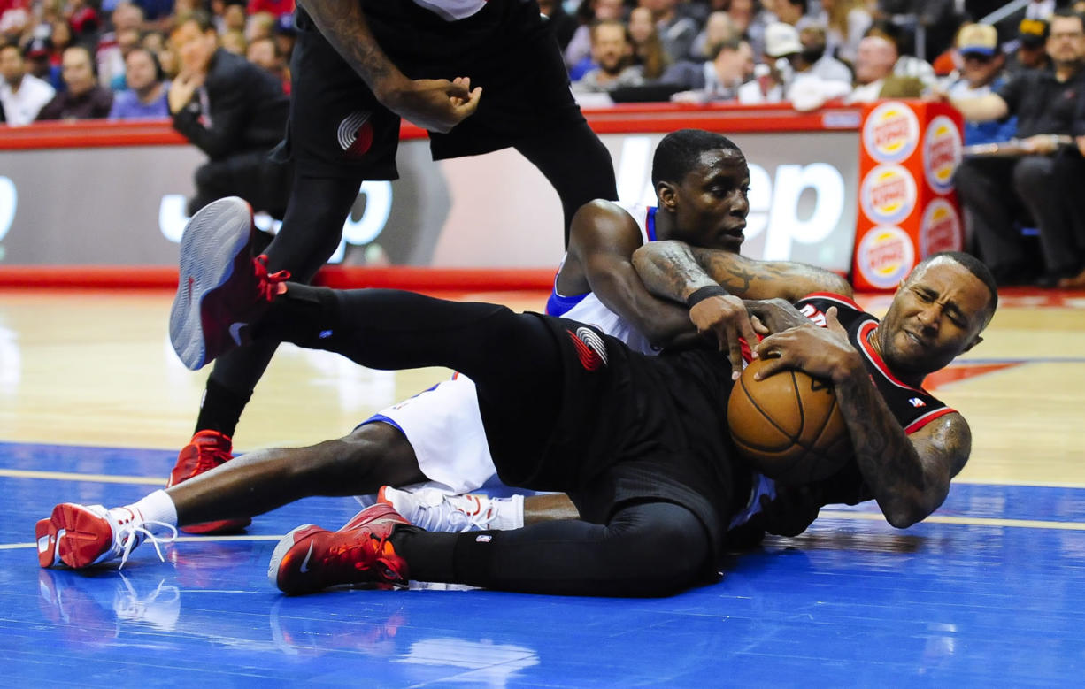 Portland Trail Blazers guard Mo Williams, front right, fights for a loose ball with Los Angeles Clippers guard Darren Collison during a preseason game Oct. 18.