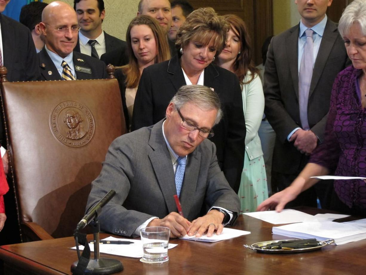 Washington Gov. Jay Inslee vetoes a section of an $8.7 billion state transportation budget Monday in Olympia. Inslee vetoed the section that had $81 million in planning money set aside for replacing the bridge connecting Portland and Vancouver, because of concerns that the state's $450 million share of the bridge's costs might not be funded by the Legislature.
