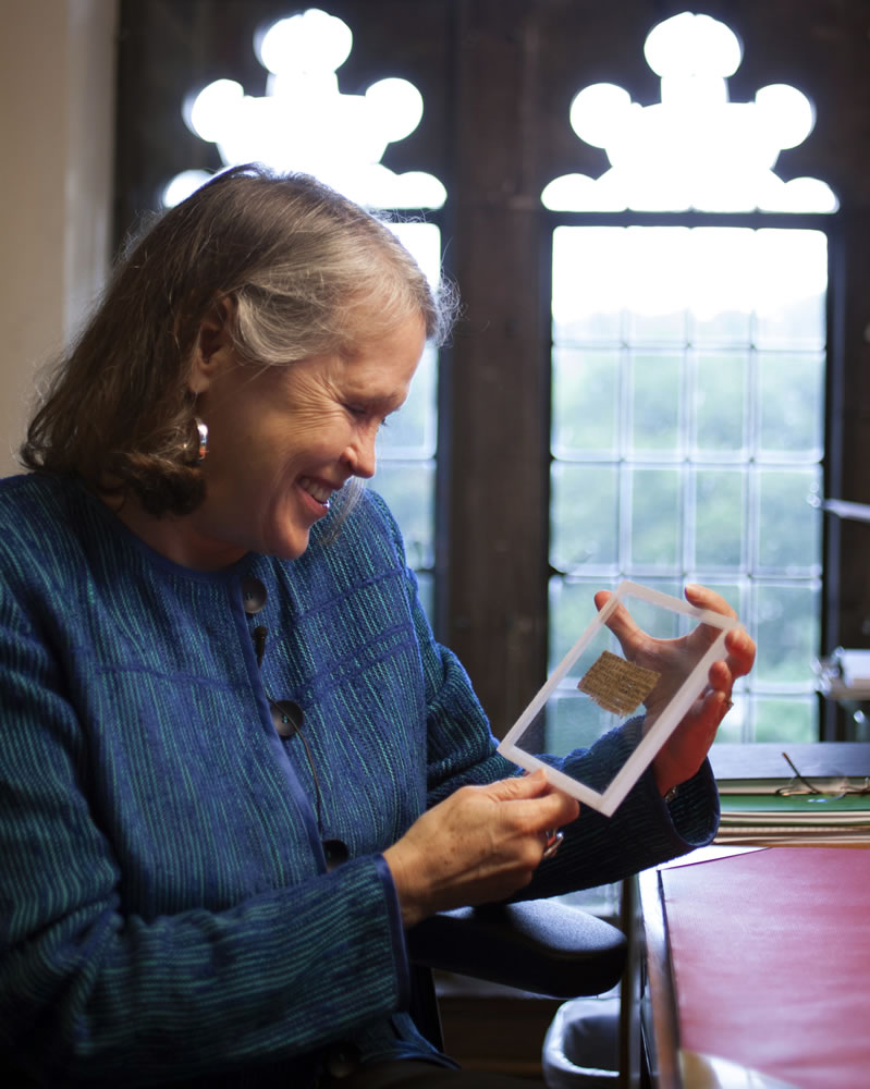 Harvard professor Karen L. King holds the fragment, which is about 11/2 by 3 inches in size.