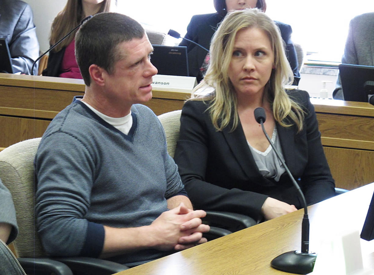 Alan Northrop, left, testifies before the Senate Law and Justice Committee in Olympia as Lara Zarowsky, right, of the Innocence Project Northwest, looks on. Northrop was exonerated by DNA evidence after serving 17 years in prison for rape, and was testifying in support of a bill that would compensate those who have been wrongfully convicted.