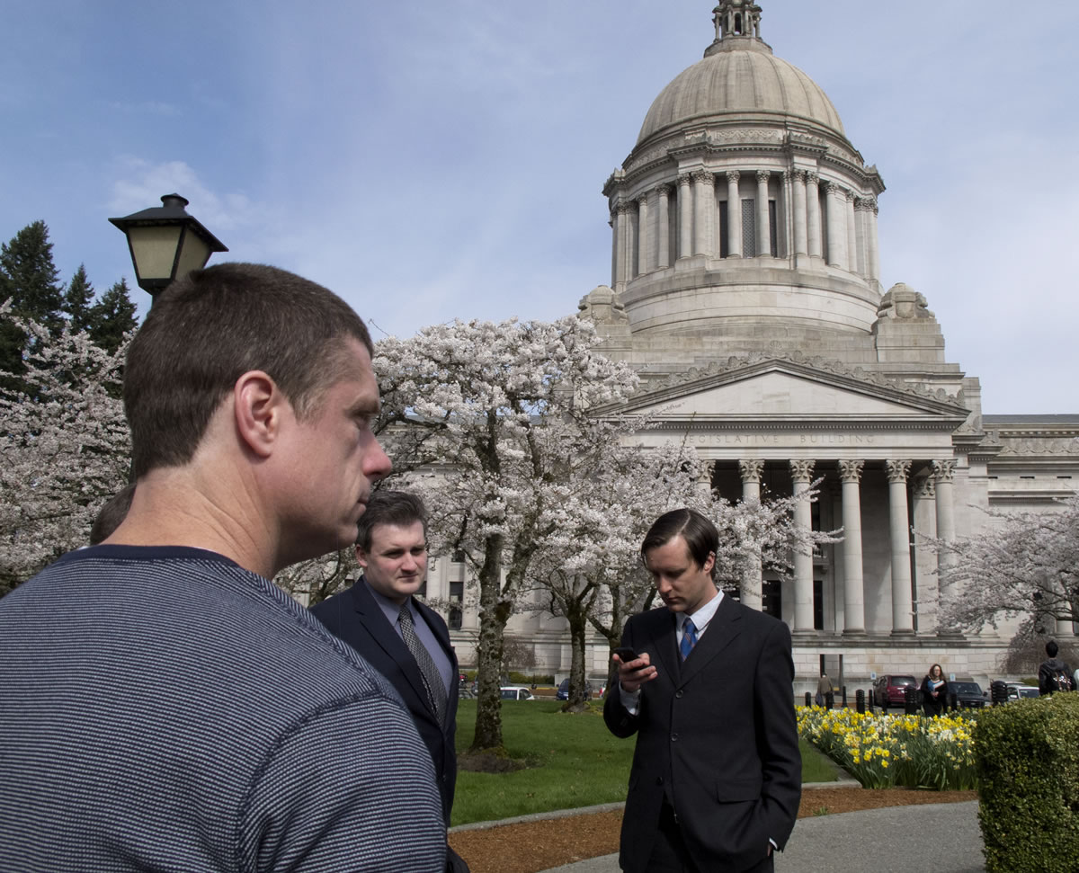 InAlan Northrop, left, takes a break outside at the Capitol before testifying at a Senate committee hearing in Olympia on March 27. Northrop was exonerated by DNA evidence after serving 17 years in prison for rape, and was speaking in support of a bill that would compensate people who have been wrongfully convicted.