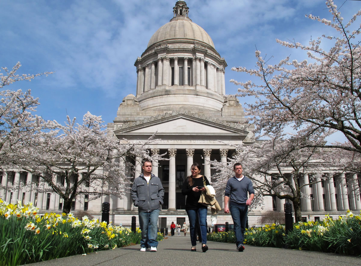 Alan Northrop, right, his girlfriend Shawna Smith, center, and Northrop's son, Alan Northrop, left, walk away Legislative Building at the Capitol in Olympia.