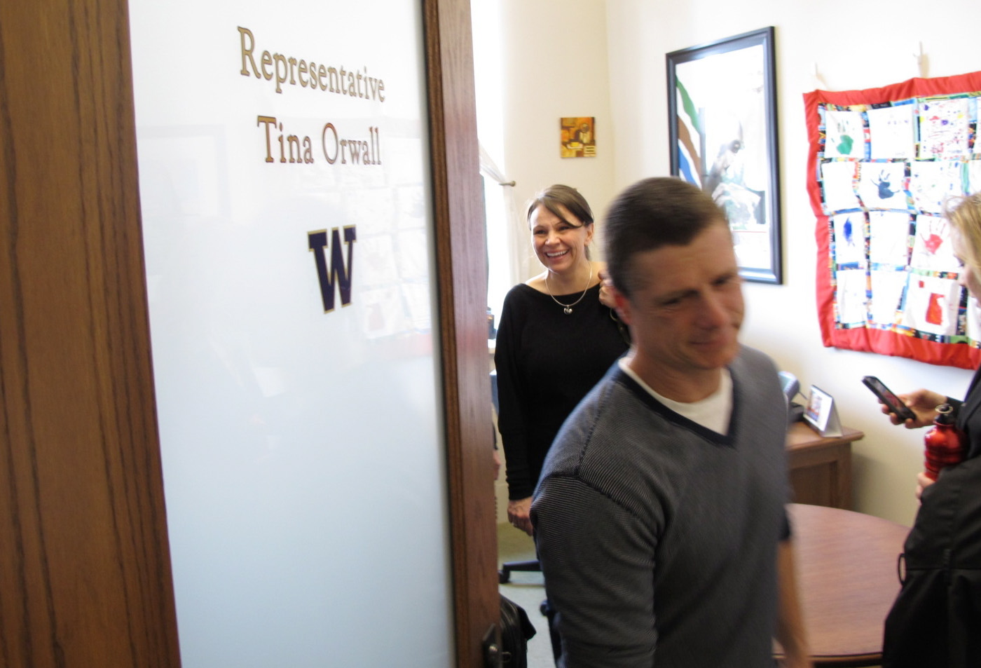 Alan Northrop, right, and his girlfriend, Shawna Smith, left, leave the office of Rep. Tina Orwall, D- Des Moines, following a meeting in Olympia.