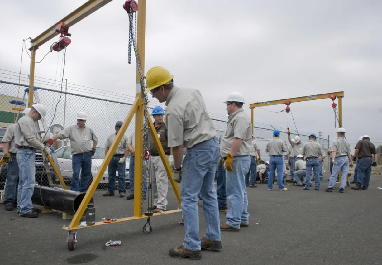 Students at The Northwest Renewable Energy Institute get a lesson in rigging as part of a wind turbine maintenance curriculum in August 2009. The Great Recession appears to have dramatically eroded the number of green industry jobs in Washington, the Employment Security Department said in a study released Monday.