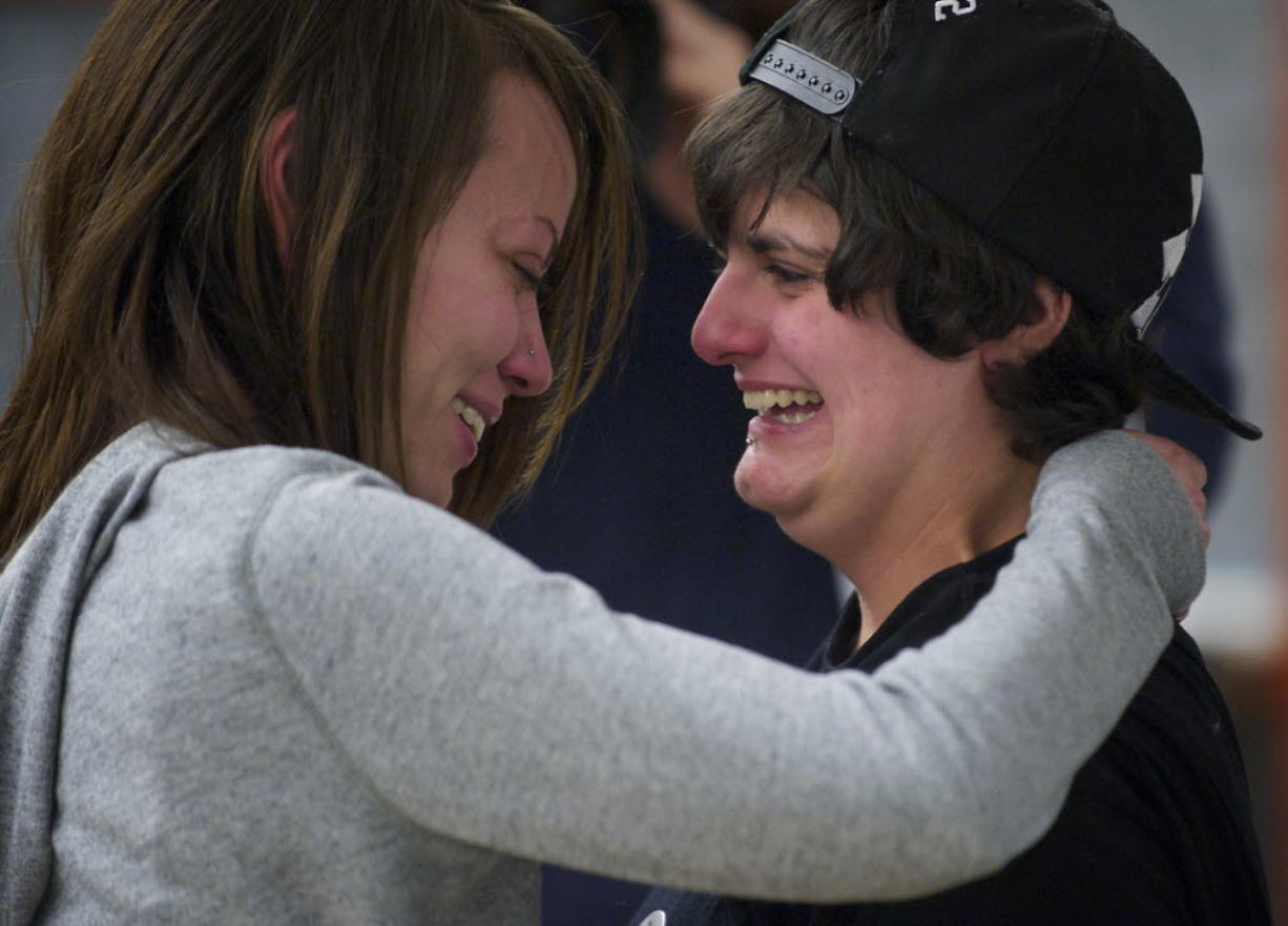 Ashley Cavner, 21, left, and Jessica Lee, 19, both of Vancouver, embrace after receiving their marriage license at the Clark County Auditor's Office today. The couple, who have been together for 18 months, arrived at 9 p.m.
