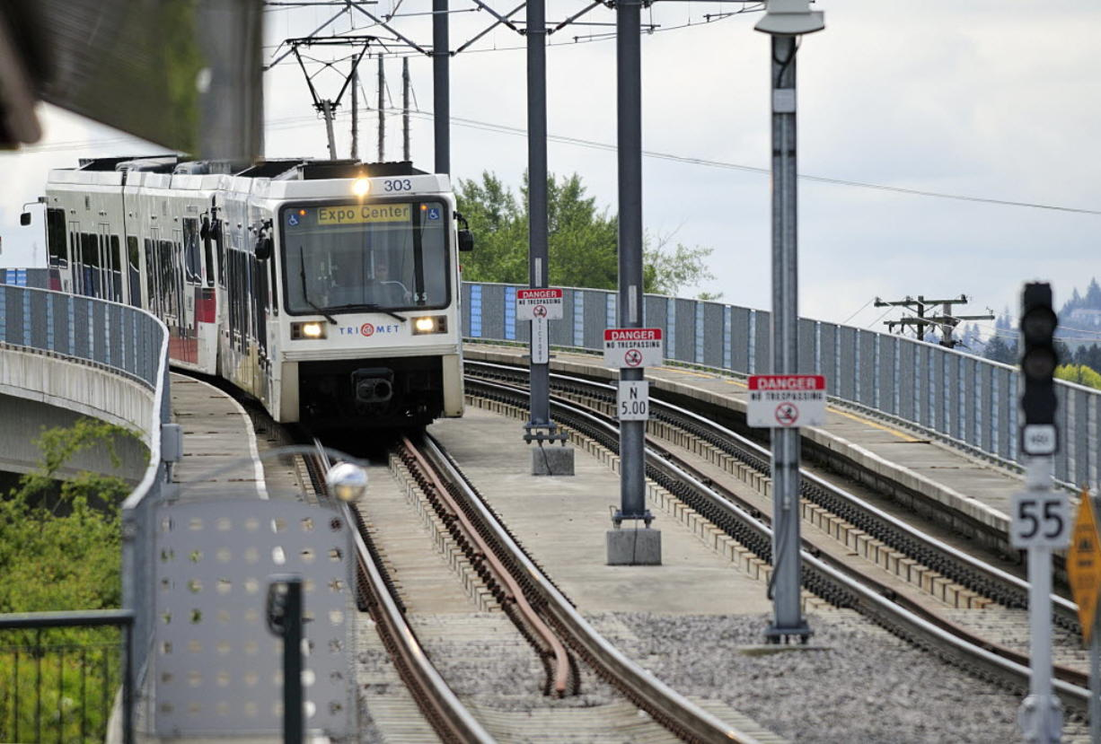 A group that failed to collect enough signatures to force a vote on light rail filed a lawsuit Monday, challenging a state law that invalidated some of their signatures.