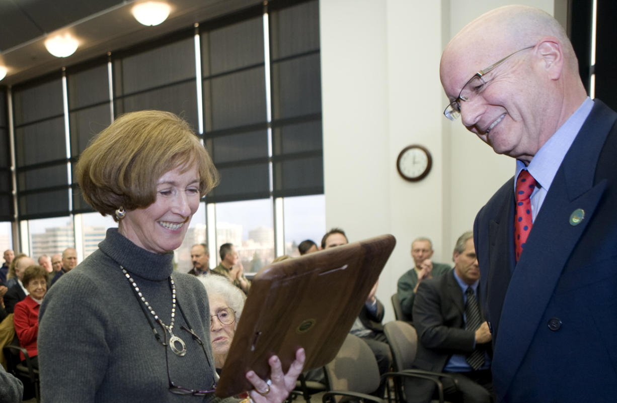 County Administrator Bill Barron gives former Clark County Commissioner Betty Sue Morris a plaque during Morris' retirement reception and 67th birthday celebration in December 2008.