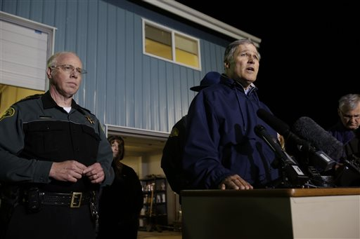 Washington Governor Jay Inslee, right, talks to reporters about the failure of the Interstate highway bridge crossing the Skagit River in Mt. Vernon Thursday May 23, 2013, dumping two vehicles into the water and sparking a rescue effort by boats and divers as three injured people were pulled from the chilly waterway. Early reports indicate this semi trailier may have struck the bridge.