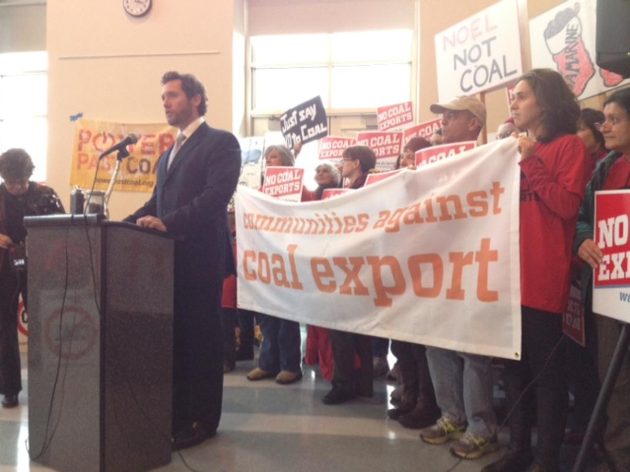 Vancouver Mayor Tim Leavitt speaks out against a proposed coal export facility near Bellingham during an anti-coal event Wednesday before a hearing on the proposal at Clark College.