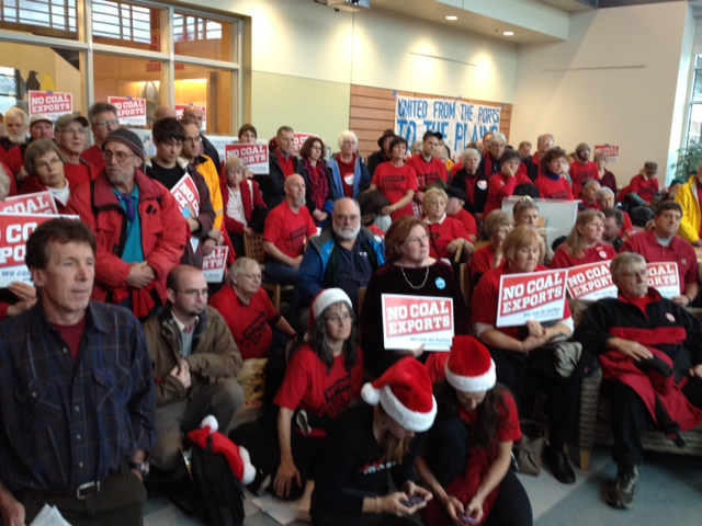 Anti-coal activists take part in a event before a hearing on a proposed coal export facility in Bellingham.