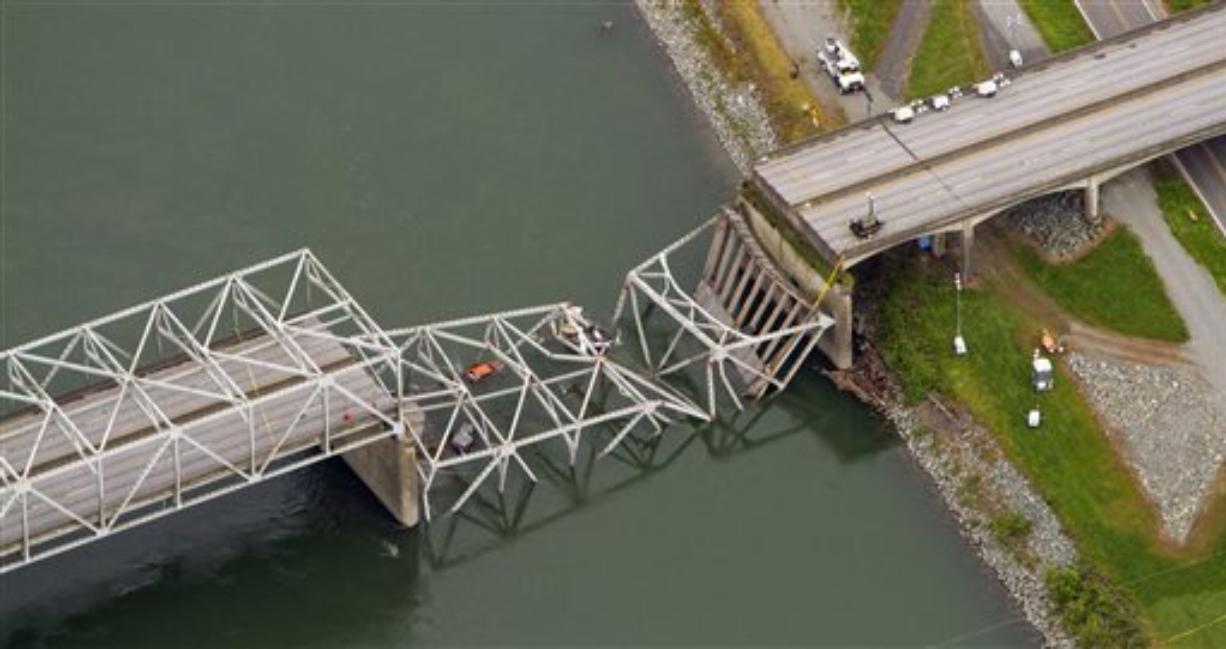 A collapsed section of the Interstate 5 bridge over the Skagit River is seen in an aerial view Friday, May 24, 2013. Part of the bridge collapsed Thursday evening, sending cars and people into the water when a an oversized truck hit the span, the Washington State Patrol chief said. Three people were rescued from the water. Washington Gov.