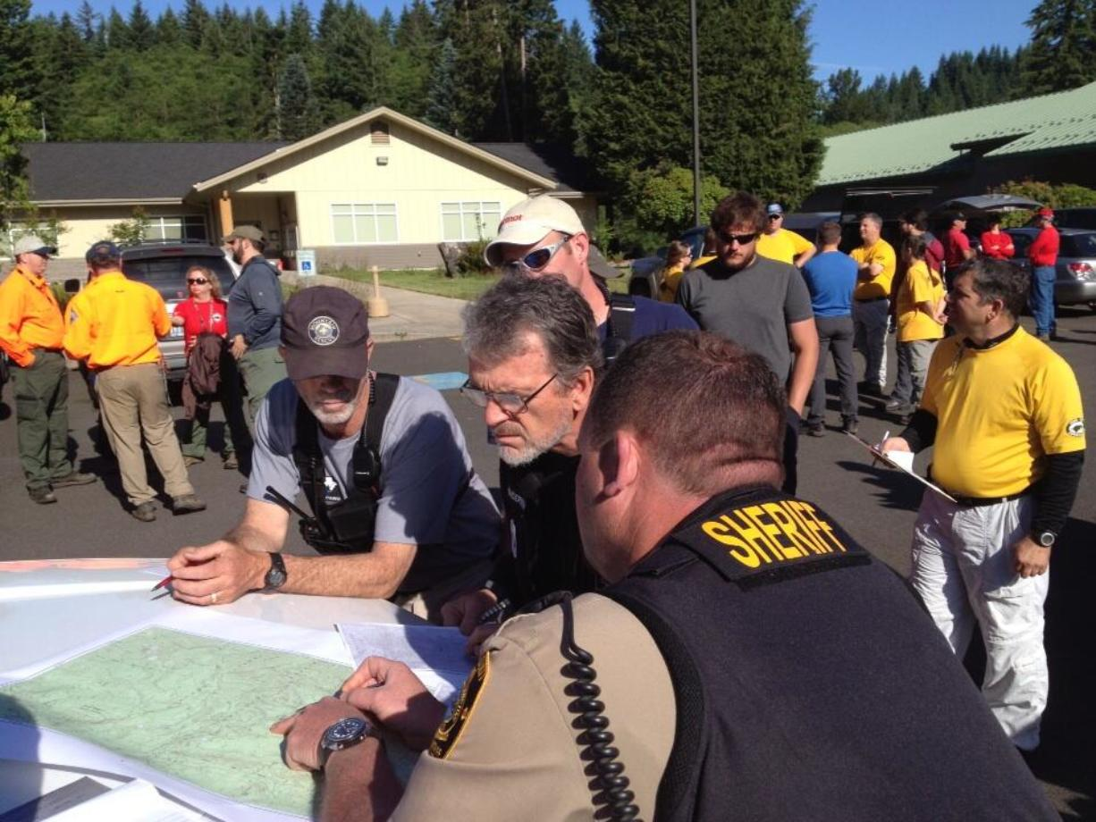Search and Rescue volunteers and law enforcement personnel gathered in Amboy early Saturday before renewing a search for a Vancouver woman who went missing on a hike on June 9 in the Gifford Pinchot National Forest.
