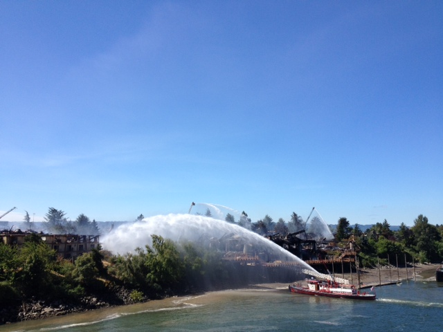 A fire boat helps put out the fire Sunday afternoon on the Columbia River.