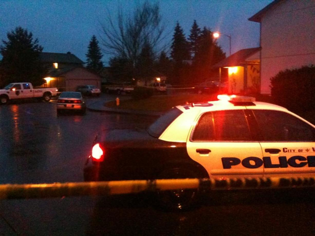 Police cars and crime scene tape surround a neighborhood where a resident shot an intruder early today.