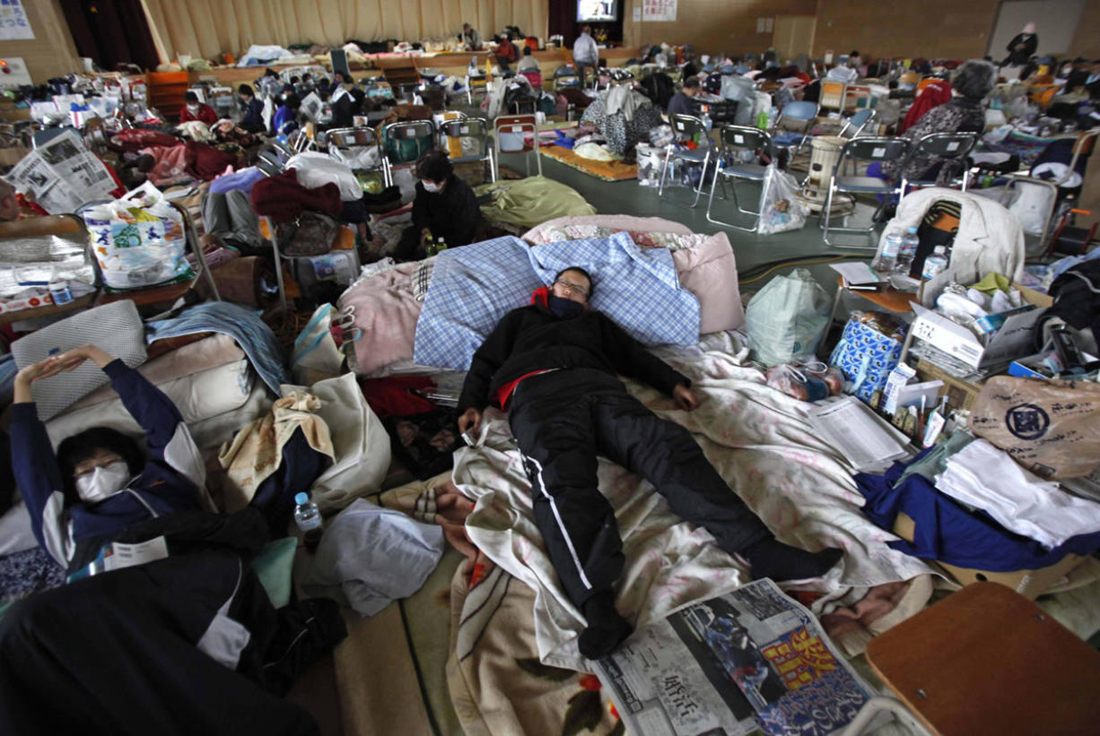 FILES/Associated Press An evacuee sleeps on a blanket at a shelter in Rikuzentakata, Iwate Prefecture, after the 2011 magnitude 9.0 earthquake and tsunami in Japan. A similar earthquake in the Pacific Northwest caused by the Cascadia fault could pack shelters for months and destroy the regional economy.