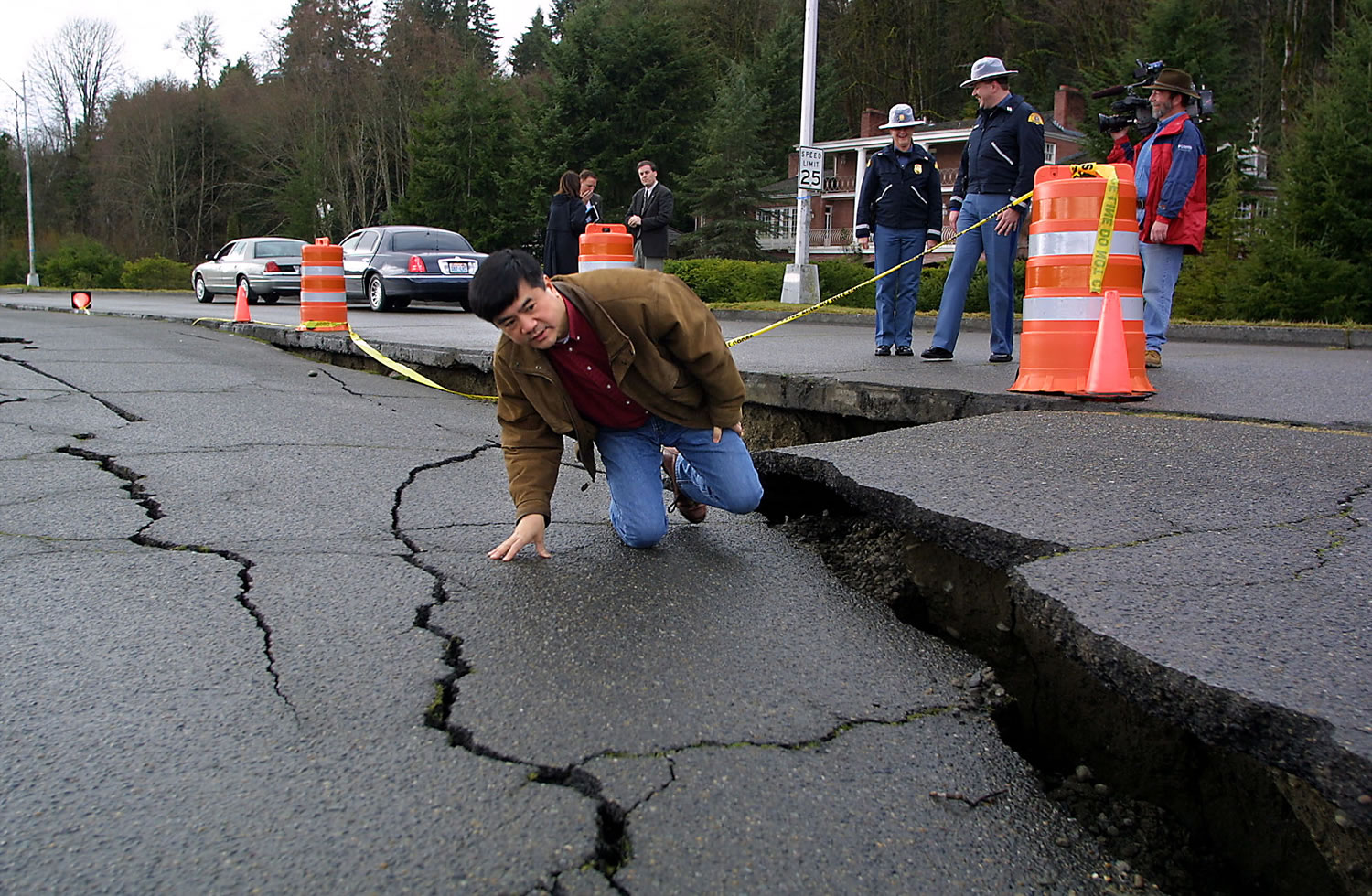 Files/Associated Press Then-Gov. Gary Locke inspects a fissure in Deschutes Parkway in Olympia after the magnitude 6.8 Nisqually quake in 2001. Worse damage is likely the next time the Cascadia fault ruptures off the Pacific coast -- the last Cascadia earthquake was a magnitude 9.0, more than 100 times as powerful as the Nisqually quake.