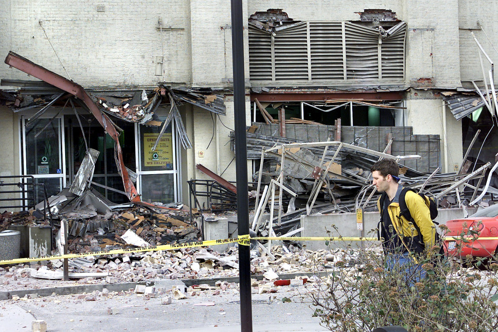 The Seattle Times files A man walks by a damaged Starbucks in Seattle after the 2001 Nisqually earthquake. The magnitude 6.8 earthquake could be small compared with a potential quake in the Cascadia fault zone. The zone created a magnitude 9.0 earthquake when it last ruptured in 1700.
