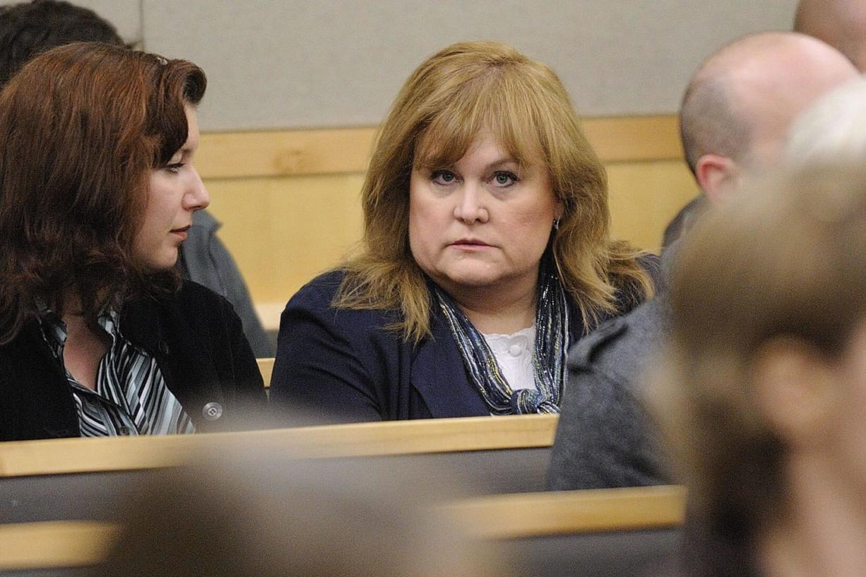 Sandra Weller, accused of locking up and starving her adopted twins, was arraigned Thursday.